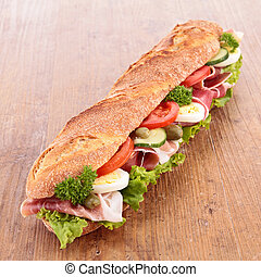 sandwich with ham,lettuce,cucumber and tomato