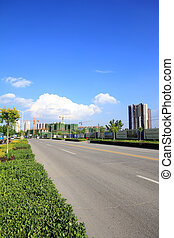 city road landscape in the blue sky