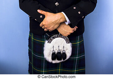 Close-up of man in kilt