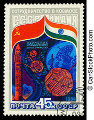USSR- CIRCA 1984: A stamp printed in USSR,  study of space cooperation between USSR and India, rocket and space saucer, circa 1984