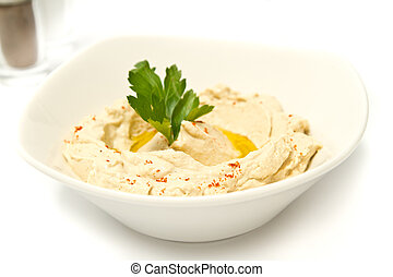 Hummus - Bowl of hummus with parsely and olive oil
