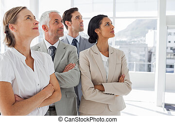 Business people looking at the same way