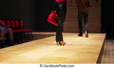 fashion models on podium - exhibition of leather