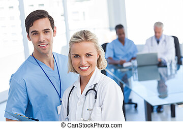 Young doctors smiling and looking at the camera