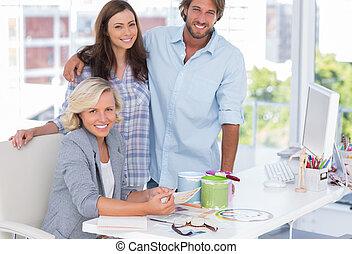 Team of interior designer at desk in bright modern office