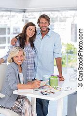 United team of interior designer standing together at desk...