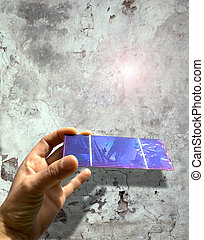 solar cell against an old wall - solar cell in a hand...