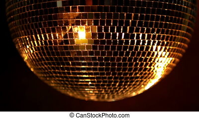 a funky discoball spinning and reflecting light. perfect...