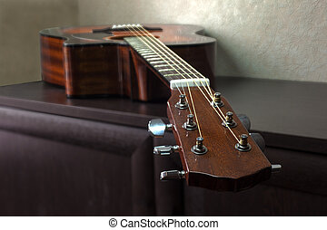 six-string acoustic guitar - brown six-string acoustic...