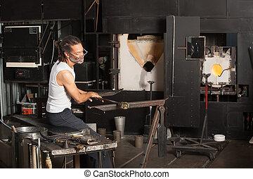 Male Working on Fine Art Glass
