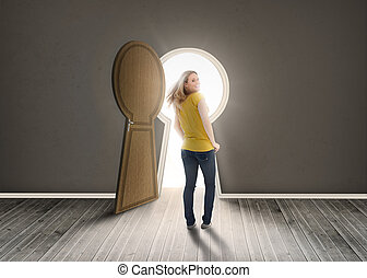 Woman walking towards keyhole shaped doorway with light ikn...