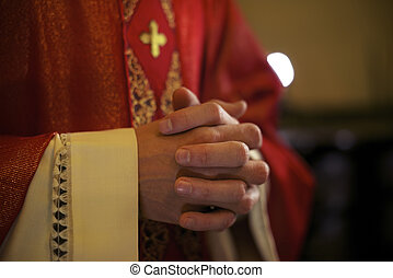 Catholic priest on altar praying during mass - Catholic...