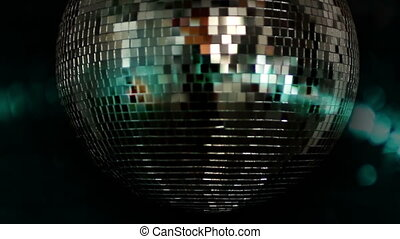 a funky discoball spinning and reflecting light perfect clip...