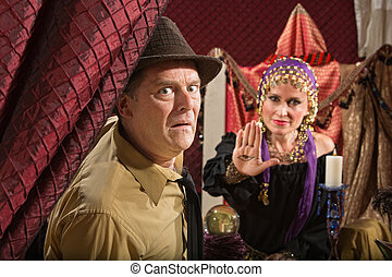 Scared Man with Fortune Teller - Scared businessman and...