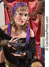 Fortune Teller Rubs the Lamp - Pretty female gypsy fortune...