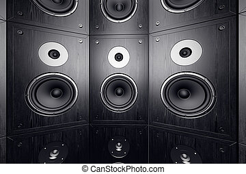 Wall of speakers. - Black, wooden loudspeakers in a stack.