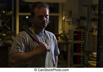 worker holding a pipe wrench