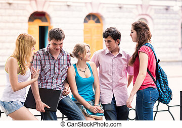 Group of happy smiling Teenage Students Outside College