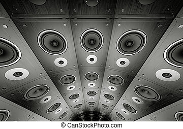 Wall of speakers. - A wall of black, wooden loudspeakers.