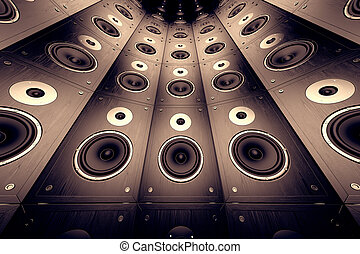 Wall of speakers. - A wall of brown, wooden loudspeakers.