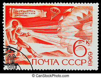 USSR - CIRCA 1969: A stamp printed in USSR, parachuting, athlete puts the parachute, circa 1969