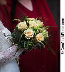 wedding bouquet - brides hand holding a wedding bouquet
