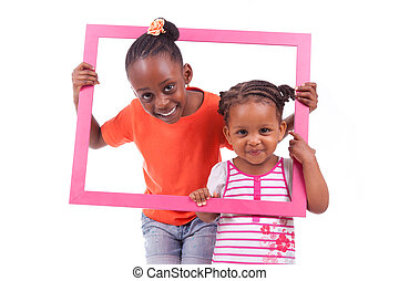 Little african american girls holding a picture frame -...