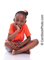 Cute little african american girl sitting on the floor -...