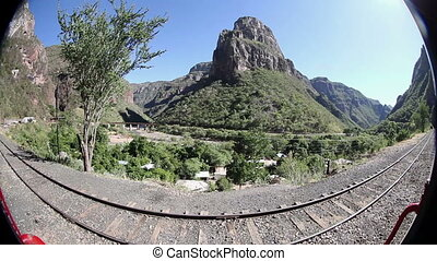 a shot from the el chepe train which passes through the...