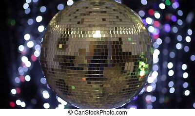 abstract funky discoball spinning with light effects and...
