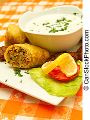 Indian cuisine - Indian meatballs and chicken wrap with...