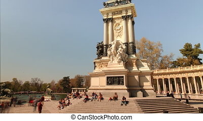 crowds of people in el retiro park, madrid on a summer...