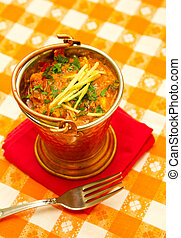 Indian food - Indian curry in a copper bowl