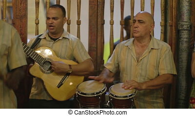 the cuban band eco caribe filmed performing the bodegiuta...