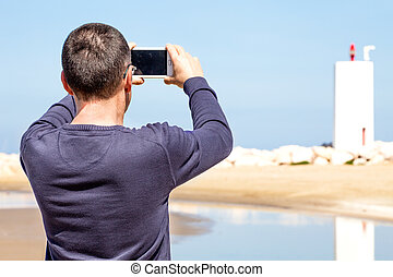 Man Photographing With Smartphone