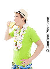happy young man drinking beer at summer