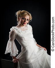 blonde woman with a white dress