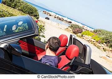 Man Watching The Beach From His Car