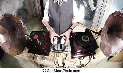 close-up crops of an older man djing with gramophones
