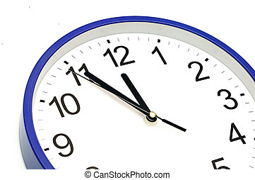 blue wall clock five minutes to twelve