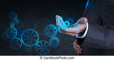 businessman hand touch blue gear to success concept -...