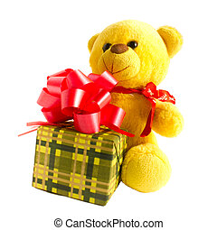 yellow teddy bear with gift isolated