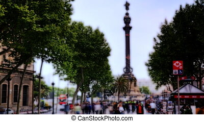 people rushing about on las ramblas, famous street in...