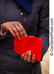 wallet - woman holding red wallet in her hand