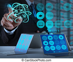 businessman hand working with new modern computer show the earth social network structure concept