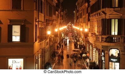 shopping street in rome, italy, at night