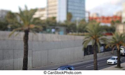 a timelapse of a street scene in barcelona at sunset, spain using tilt and shift lens