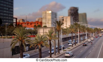 a timelapse of a street scene in barcelona at sunset, spain...