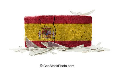 Brick with broken glass, violence concept, flag of Spain