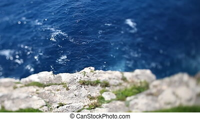 sparkling mediterranean sea shot from top of cliffs